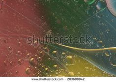 Abstract pattern of colored oil bubbles on water by Nelson garrido Silva, via Shutterstock
