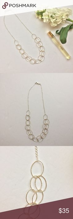 Silver Ring Double Chain Necklace Silver necklace with double attached strands. The strands are looped rings. Clasp opening. FAS Made in Italy. Jewelry Necklaces