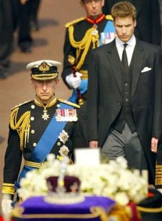 Prince Charles and Prince William walk behind the Queen Mother's casket on the day of her funeral.