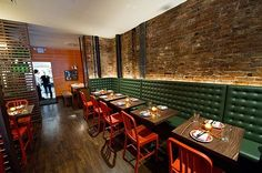 What I like here is that the brick is featured with the indirect lighting. Though art on the walls would feel warmer