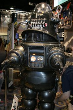 "Robbie the Robot, from the classic 1956 space movie ""Forbidden Planet,"" one of the three famous Hollywood robot designs of veteran art director Robert Kinoshita. The other two were, of course, the Robot from ""Lost in Space,"" and Tobor from the 1954 film ""Tobor the Great."" Appearance at San Diego Comic Con, 2006; Wikimedia Commons photo by Patty Mooney, shared under Creative Commons license, details @ http://creativecommons.org/licenses/by-sa/3.0/deed.en"