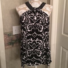 INC Top Black and White sleeveless top. Lays very nice. Perfect condition. Non smoking home. No Trades. INC International Concepts Tops