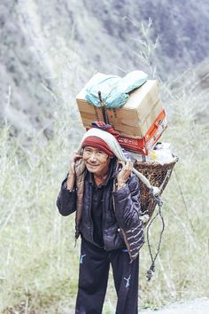Porters (known as Sherpas) carry an average of 80kgs on their backs. #Nepal