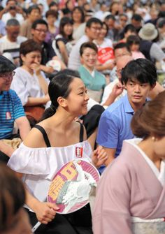 Former figure skaters Mao Asada (L) and Takahiko Kozuka (R) enjoy sumo bouts during day eleven of the Grand Sumo Nagoya Torunament at Aichi Prefecture Gymnasium on July 19, 2017 in Nagoya, Aichi, Japan.
