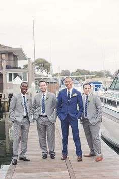 grey groomsmen with blue suit for groom #groomsmen #groom #weddingchicks http://www.weddingchicks.com/2014/01/29/seaside-wedding-3