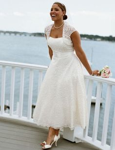 The short dress is good for the beach, but I still like the floor-length gowns... LOVE that lace shrug/sleeves, though!