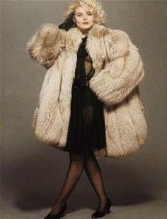 Fur Fashion: Model Wearing a Huge Fur Coat