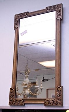 to go with our art deco dining room table?  ART DECO GOLD GILT MIRROR