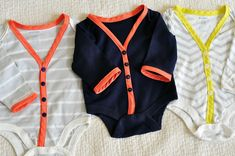 MAKE YOUR OWN onesie-cardis! pretty easy - just cut the v-neck and center, trim with jersey, sew back with buttons. so. freaking. cute.
