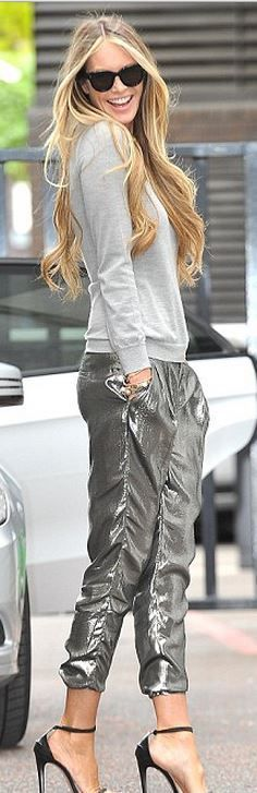 Who made Elle Macpherson's silver pants and black sunglasses?