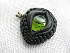 Large Black Dragon Eye with Green Glass Pendant.  Kind of creepy/cool!  I wouldn't wear it but it's cool to look at!
