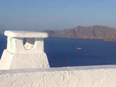 Nothing but bright sun, blue sea, and white buildings in the stunning town of Oia on the island of Santorini. Great wine, too!