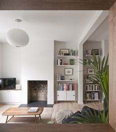 See How Archer + Braun Gave This London Row House a Modern Makeover is part of Minimal Home Accessories Living Rooms Originally built for dockworkers, the historic property desperately needed a lift - Living Room Light Fixtures, Living Room Lighting, Living Room Spotlights, Ikea Living Room, White Living Rooms, Front Rooms, Living Room With Fireplace, Fireplace Design, Fireplace Ideas
