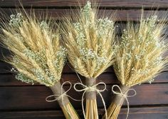 A simple bridesmaid or table decoration bouquet of summer harvested wheat with the option of additional flowers mixed in. This bouquet is wrapped in a choice of wraps styles available in the drop down menu. Wedding Table Flowers, Bridal Flowers, Wedding Bouquets, Wedding Shoes, Wedding Dresses, Diy Wedding Decorations, Flower Decorations, Wedding Centerpieces, Wheat Centerpieces