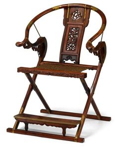 Chinese huanghuali and mixed hardwood folding horseshoe-back chair     The folding horseshoe chair with huangtong braces, rectangular stretcher seat, and backsplat pierced with stylized dragon design and a fu dog among clouds.     H: 44 in. W: 29 in. L: 23 in.
