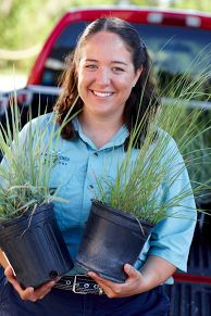 Director of Marine Studies Jenna Cummings prepares the Hough Campus marsh grass harvest garden.
