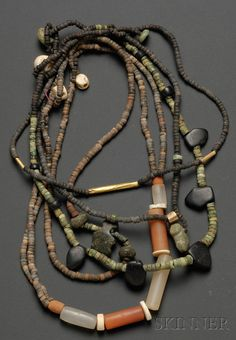 Colombia | 5 strands of mostly cermaic and stone (carnelian and crystal mainly) | Pre-Columbian; ca. 1000 - 1500 AD | 356$ ~ sold