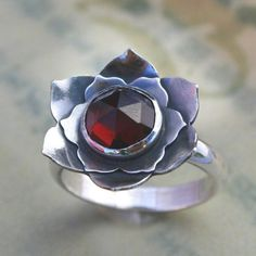Stirling silver with Garnet lotus ring. Handmade. Ordered through Etsy. My engagement ring!!!!