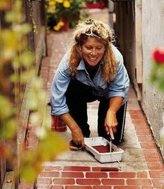 Pretty up your ugly concrete...paint fake bricks!