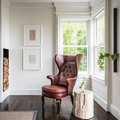 A reading corner in this San Francisco, Calif., home features an exotic wingback chair upholstered in oxblood leather by Jean de Merry and a petrified wood table.