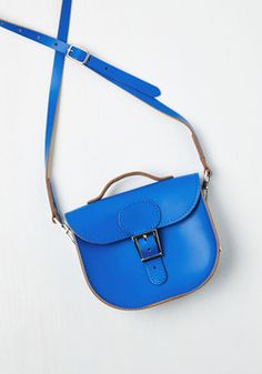 Have Style, Will Travel Bag in Cobalt. From plane to train to automobile, you boast eye-catching zeal with this charming sapphire crossbody bag from hard-to-find UK brand Brit-Stitch - whose history began in 67 with a milkmans cash bag and continues through you! #blue #modcloth