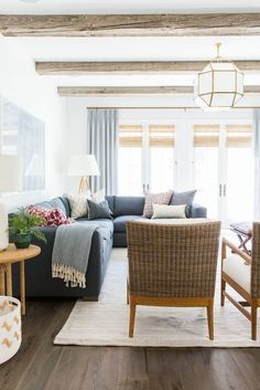 Living room remodel in a California home. Living room design and inspo. Wood beams, dark wood floors, white walls. Living room seating.   Studio McGee Blog