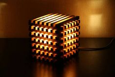 A stylish wooden cube lamp is made of natural wood by hand. It will serve as a decoration of your interior, and also help create a warm atmosphere of comfort in the evening. Inside the wood is a brand new lamp Wooden Table Lamps, Bedside Table Lamps, Led Pendant Lights, Pendant Lamp, Pendant Lighting, Pallet Ideas Easy, Bedside Lighting, Brass Lamp, Wooden Cubes