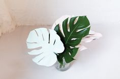 DIY painted foliage: http://www.stylemepretty.com/living/2015/09/06/diy-painted-pastel-foliage/