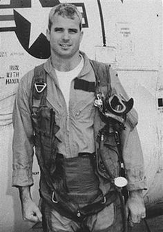 In this picture politician John Mccain poses next to a plane used in the Vietnam war. This picture was taken in 1965 when he was a U. Vietnam War Photos, Vietnam Veterans, Young John Mccain, Military Men, Military History, Military Veterans, American War, American History, Peace