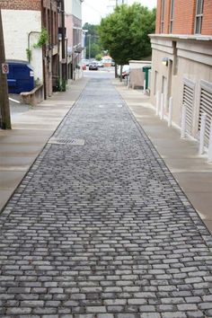 With the appearance of an old granite paver that has been in the ground for centuries, Alleyway Cobble™can be used as a standard paver or permeable interlocking concrete pavement (PICP), depending on how you install it. This 4-piece system is crafted with a natural stone-cleft finish and rounded edge for the look and feel of time-worn quarried stone.