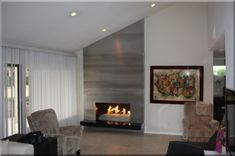 Floor to Ceiling Brushed Aluminum Custom Fireplace Surround  The next few pictures were sent to us by Marsha Dashefsky from Palm Springs, CA.  Marsha wanted a custom floor-to-ceiling brushed aluminum fireplace surround.