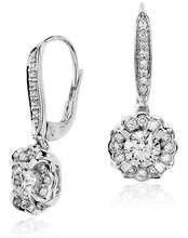 Ve529 Diamond Fashion Earrings  Earring Information  Metal:  18k White Gold  Length: 1 inch  Backing:  Lever Backs  Width:  3/8 inch  Rhodium Plated: Yes