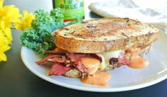 This classic grilled Tasty Reuben Pastrami on Rye Bread Sandwich with sauerkraut, Swiss cheese and Russian dressing will make any Reuben lover smile!