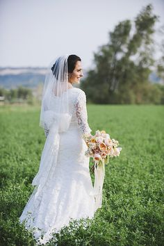 modest lace wedding gown with bow
