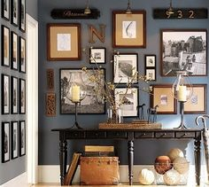 Frames on the hallway wall with blue grayish background.