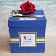 *Your choice of colors: shown painted in royal blue with light yellow and gold. Beautiful Beauty and the Beast Card Box for any special occasion. Custom card will be formatted with for information. Colors and embellishments are customizable, please mess Beauty And The Beast Wedding Theme, Beauty And Beast Birthday, Wedding Beauty, Beauty And Beast Party, Sweet 16 Decorations, Quince Decorations, Quinceanera Decorations, Quinceanera Favors, Beauty Box