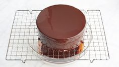 "Jacques Torres's Shiny Chocolate Glaze Gelatin is the key to a glistening chocolate glaze that stays put on your cake. Jacques Torres prepared this recipe with Martha on Episode 501 of ""Martha Bakes. Mirror Glaze Recipe, Mirror Glaze Cake, Cake Icing, Cupcake Cakes, Chocolate Mirror Glaze, Chocolate Ganache Glaze, Whipped Ganache, Ganache Frosting, Chocolate Icing"