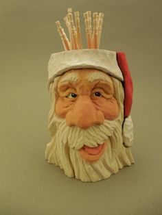 This is a hand carved Santa toothpick holder, It has a small amount of wood burning, painted with acrylics. measurements are approximately 3