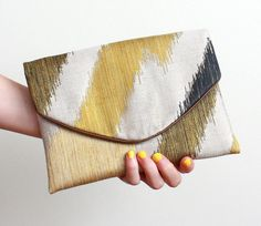 Green zigzag Lolie envelope clutch. $122.00, from MlleBagatelles onEtsy.