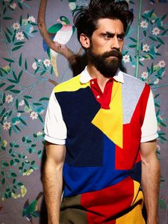 i really love this cubist/blocky/modern men's shirt! and this dude has a really intense expression on.