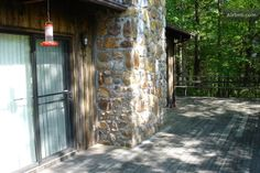 Stone fireplace from the outside - i like the overgrouted stone
