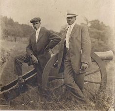 About 1915 - Two handsome young men posing with a cannon in park-like setting -- do you think it's a Civil War battleground?
