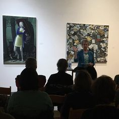 Jan Haag presenting and surrounded by art.