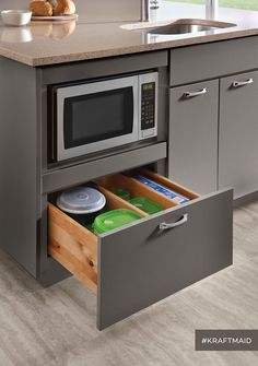 7 Ways To Create A Kitchen That Improves The Life Lived There - Microwave Oven - Ideas of Microwave Oven - A base microwave cabinet frees up counter space and leaves plenty of room for kitchen storage right underneath. (Cabinets in High-Gloss Greyloft) Kitchen Microwave Cabinet, Kitchen Drawers, Kitchen Cabinet Design, Diy Kitchen, Kitchen And Bath, Kitchen Storage, Microwave Oven, Microwave In Island, Microwave Storage
