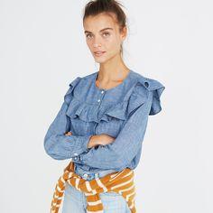 A pop-on yarn-dyed chambray top with a ruffled neckline and easy-to-roll sleeves. Ideal for an indigo-on-indigo situation? We'd say so. <ul><li>True to size.</li><li>Cotton.</li><li>Machine wash.</li><li>Import.</li></ul>