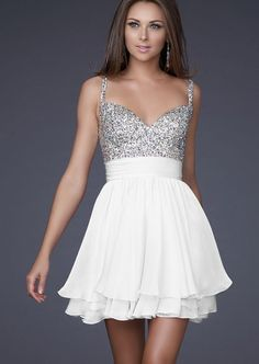 Love anything white with rhinestones! The structured top is so pretty with the flowy skirt