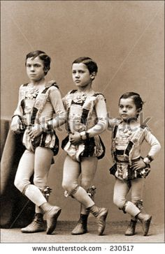 Google Image Result for http://image.shutterstock.com/display_pic_with_logo/903/903,1111514573,8/stock-photo-vintage-photo-of-young-circus-performers-230517.jpg