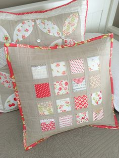 "Carried Away Quilting's free pillow tutorial, ""Love Notes"" is perfect for mini charm packs, prairie points, and bits of trim. Sample features Fig Tree fabrics with Moda Cross Weave in sand for sashing and borders."