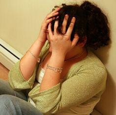 depressed teen holding her head