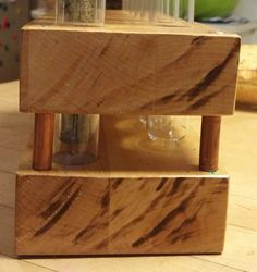 he used long screws to attach the two blocks together, but rather than letting the threads of the screw show through, she surrounded each one with a bit of copper pipe. Test Tube Spice Rack, Diy Spice Rack, Diy Storage Containers, Copper Accents, Diy Organization, Wood Boxes, Kitchen Storage, Spices, Test Tubes